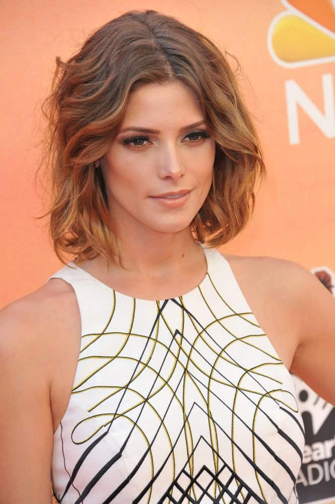Ashley Greene rocks this shirt bob with brown and honey golden highlights that are both subtle yet show up very beautifully. The hair has been styled into waves which make it look simply stunning.