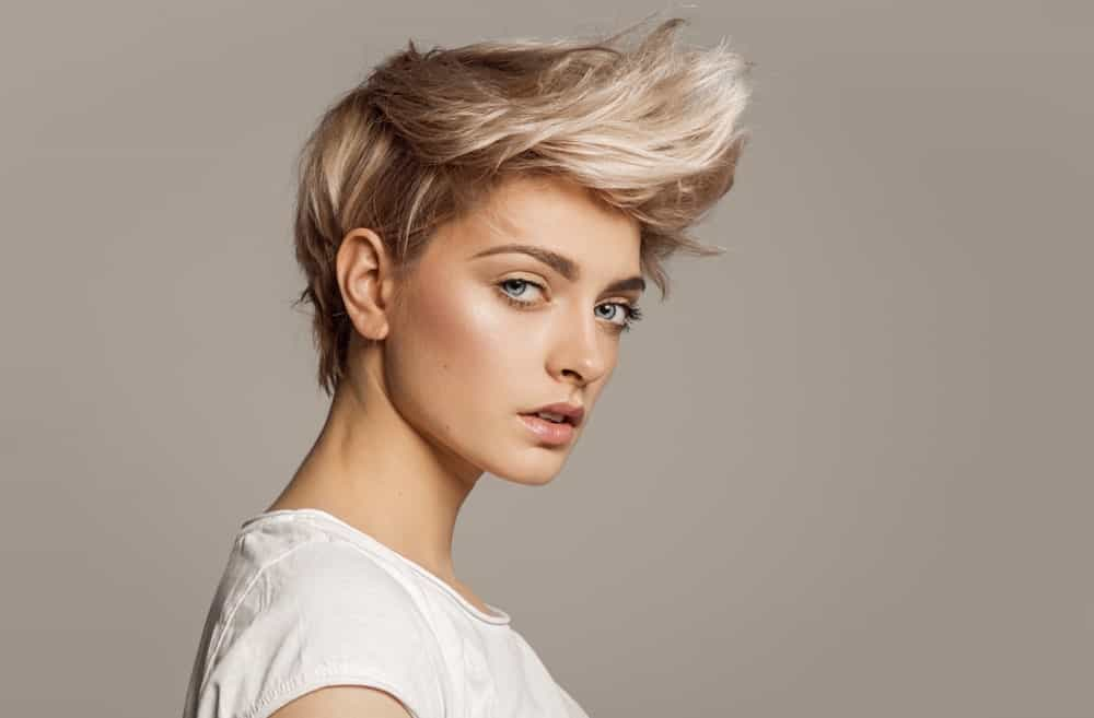 If you want to highlight your jaw and cheekbones, try a super-short hairstyle with a faux hawk. You can also personalize the look by asking your stylist to color your front hair in a contrasting hue to your back and side hair.