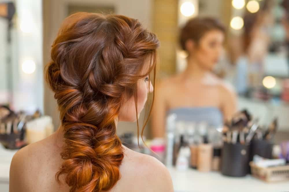 This is the perfect formal hairstyle for long dyed hair. With braids, twists, and twirls, the redhead hairstyle looks absolutely stunning. Whether you are going for a fancy dinner, attending a wedding, or an office dinner, this hairstyle is perfect to add the touch of elegance that you need. Notice how the hair dyed in different tones play a part in bringing focus to the hair and defines the hairstyle.