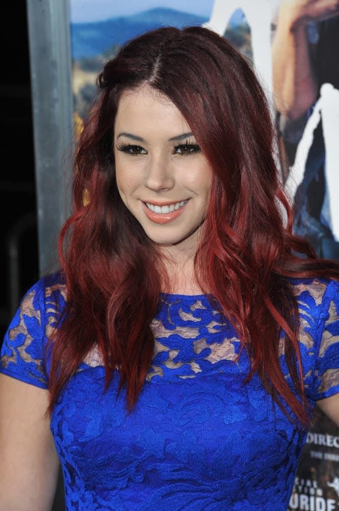 If you feel like dying your red hair a tinge darker or you already have dark hair and wish to get some red highlights, then Jillian Reed's hairstyle provides a guideline on how best to go about it.
