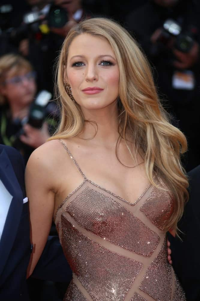 Straight hair doesn't mean it always has to be straight; you can always jazz it up with new styles. Blake Lively looks beautiful with her straight hair styled into big, soft waves that graciously fall onto her shoulders.