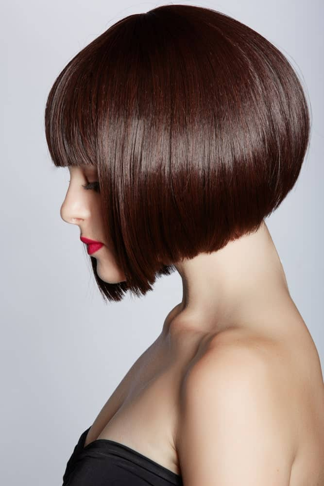 This has to be one of the most stunning and absolutely chic bobs that go from short in the back to slightly longer in the front. It also appears to be a super voluminous style with short bangs in the front to give the hair a little texture.