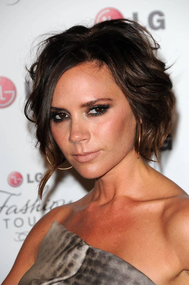 While she is well-known for her famous angular bob, here we see the inspiring woman, Victoria Beckham, rocking a different layered bob haircut. A soft feathered cut emphasized by a lengthy, tousled lock framing the face is a smart way to look bold and stylish.