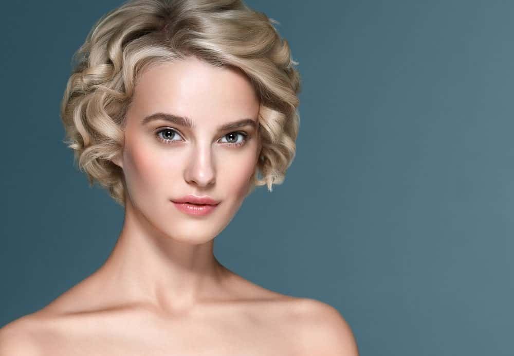 Another classic short hairstyle, this is an uber-short pixie-like bob with small tight curls going all over the head. While it does look like it has come right of the ancient era, it still looks super chic and modern.