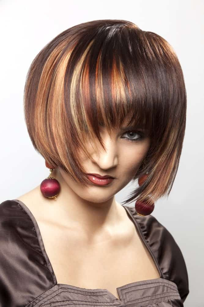 Anyone aiming for a bold and fierce hair look should definitely get this. This is a short, sleek bob with a lot of colors like orange, red, brown and yellow. These highlights are absolutely stunning and funky.