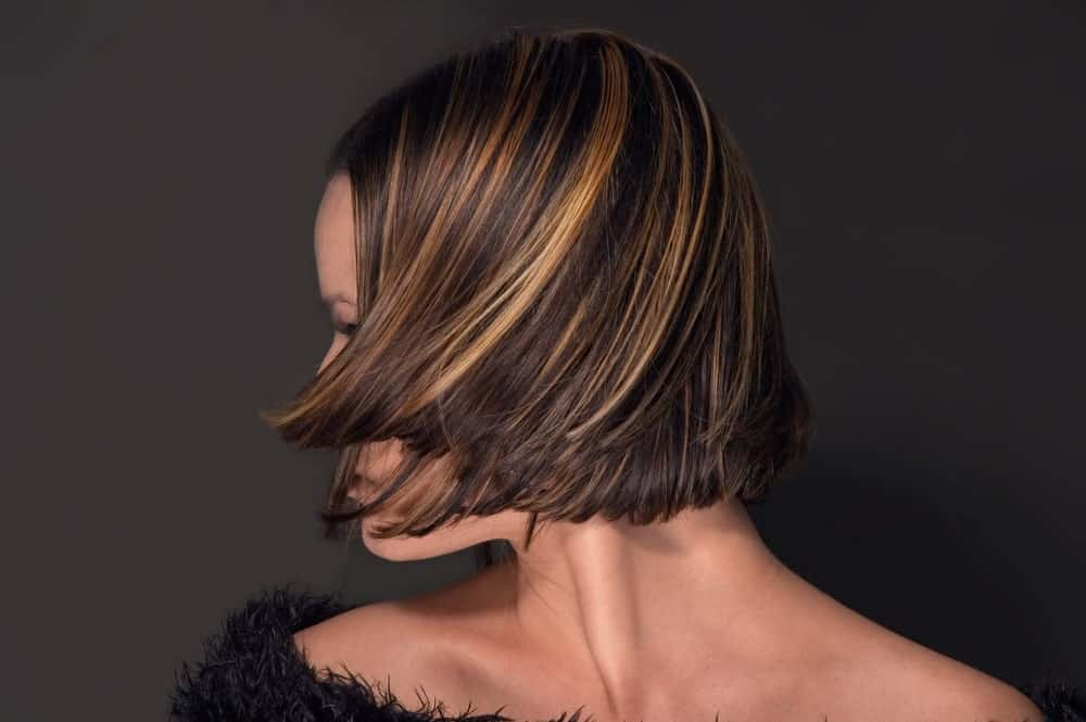 If you have short, brown hair and are looking to transform them, this is an excellent hairstyle for you. It has shades of light brown and light gold going all over from top to bottom, making it look absolutely beautiful.