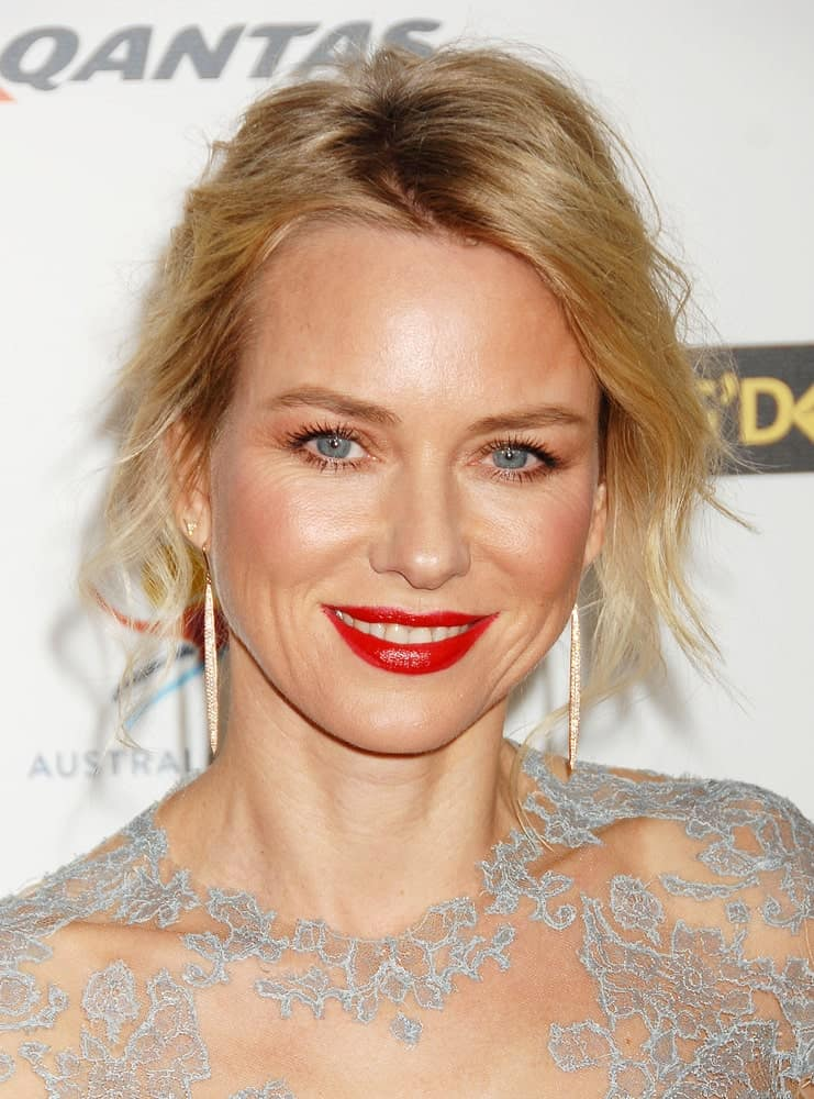 Chic and graceful best describes this hairstyle donned by the beautiful Naomi Watts. While it appears to be a slightly messy look, it's actually very stylish. Loose strands of hair in the front with a side parting and hair pulled back from behind, one could easily pull this look off at an evening dinner or a formal party.