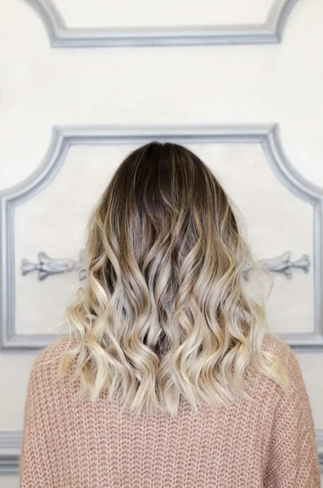 This is a stunning balayage highlighted look with dark shaded hair at the top followed by a mixture of silver, ash and blonde low lights that have been slightly curled from the bottom, making it look simply gorgeous.