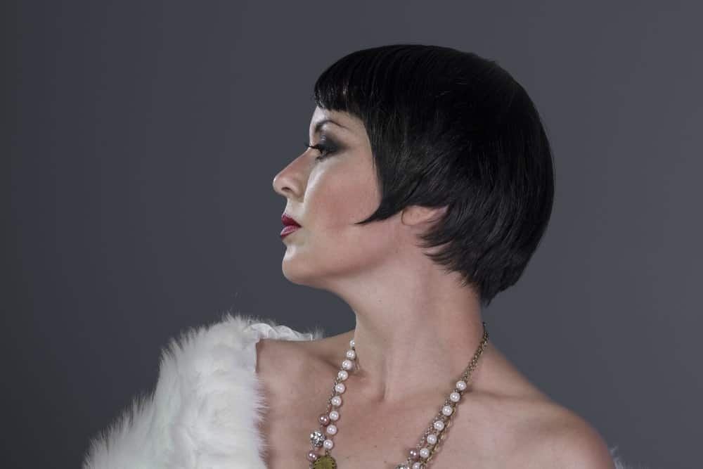 "Straight out of ""The Great Gatsby,"" this flapper-style cropped look is an easy, low-maintenance and effortless look for some elegance and glamour. This retro hairstyle looks good on women of all ages."