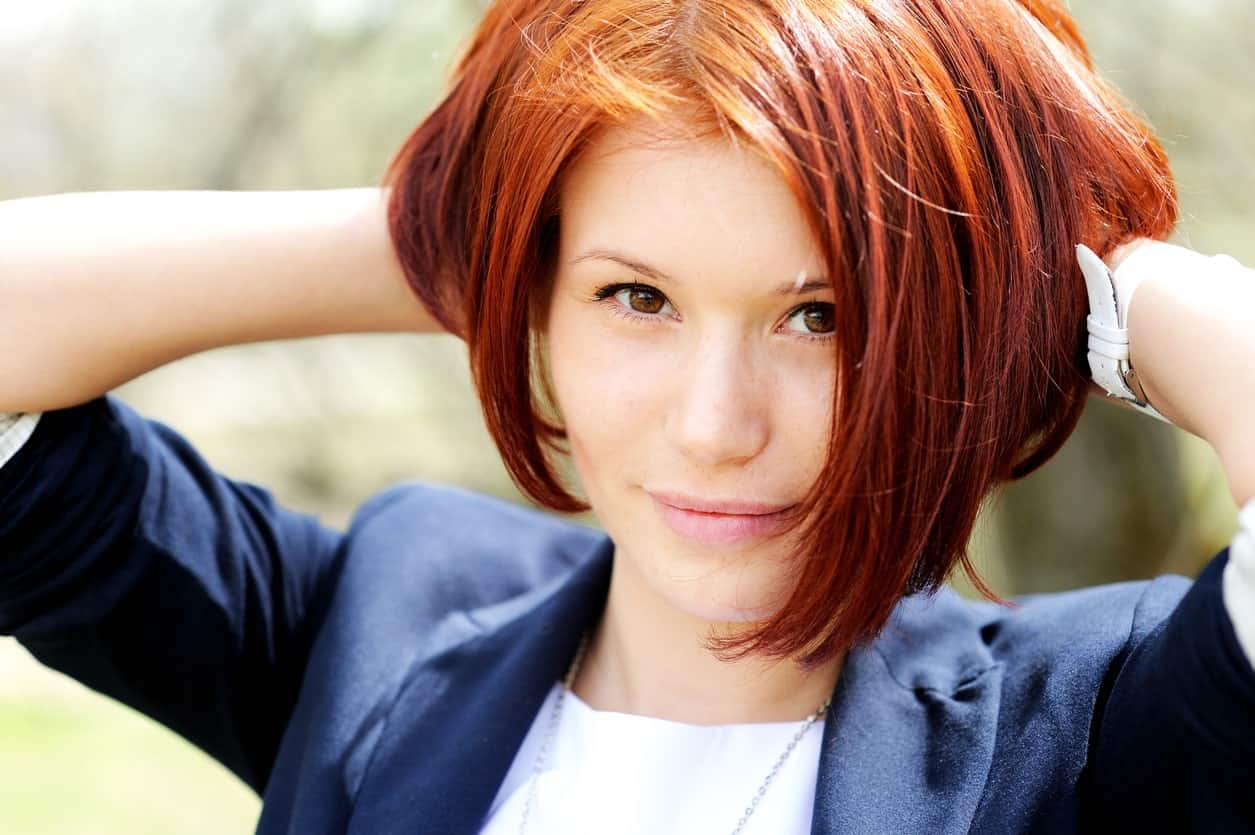 Like we mentioned earlier, redheads need not worry about several 'beauty' aspects since they look stunning no matter what. But if you are still conscious about having a round face profile, then a deep angular bob like this can ease your worries. This is because the slant strands that are longer at the front give a sharp and pointy look, thereby balancing a fuller face.