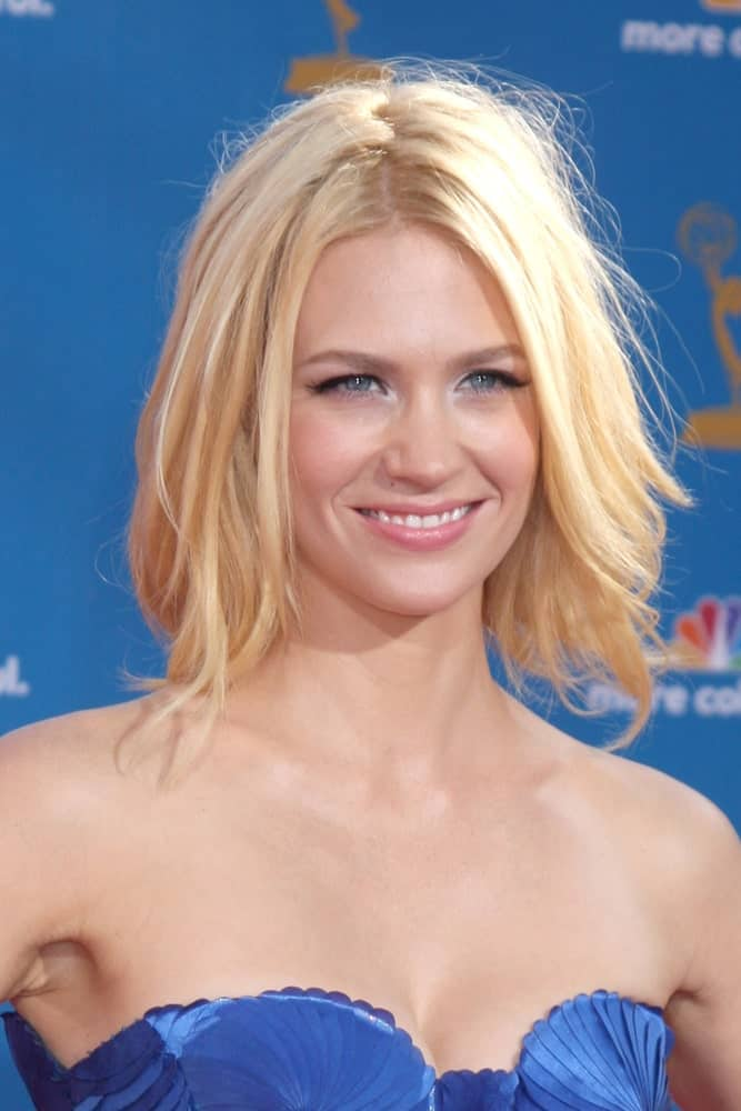If cute and adorable had a face, it would be January Jones'. She looks absolutely pretty in this hairstyle with an uneven middle parting and individual, loose strands of hair falling on either side of the face.