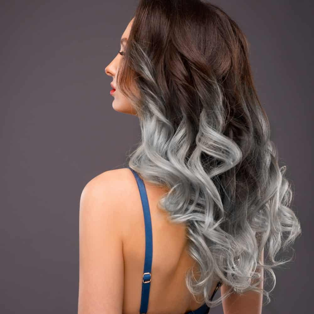 Not everyone can perfectly don a risky hair color combination, but for all those who can, this is the best one for you. This is nothing short of beautiful with ombre hair from the top followed by low silver lights all the way down. It is simply funky, pretty and just so unique!