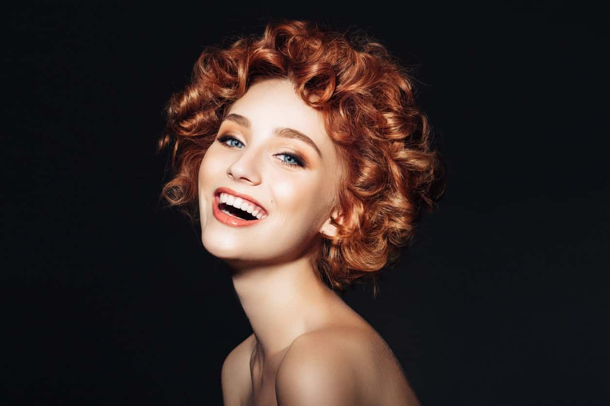 Short hair shouldn't stop you from going for such coily hairstyle. Besides, it will also give you a youthful, playful look.