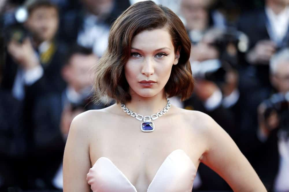 This is the beautiful Bella Hadid absolutely rocking her short hair that has been cut into a short angled bob. Although simple, there is a very obvious wave going on in the middle of the hair that gives it a little dent. If anything, it takes the look to a whole new level, making it super chic and unique.