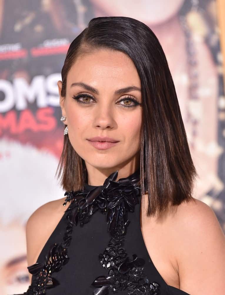 All those who love jet-straight and sleek hair will absolutely love this hairstyle. This is Mila Kunis looking amazing in this smooth and shiny bob that sports an equal, single length. It has a clean side parting, and the hair from one side has been swept all the way back while from the other side it has been set loose in front of the face.