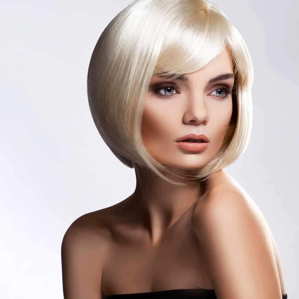 Not everyone can pull off short hair but if you think you can, you ought to get your hair styled this way. It is a sleek short bob with small bangs in the front, and the hair from the bottom has been turned inwards. If anything, this hairstyle will definitely get you some head turns!