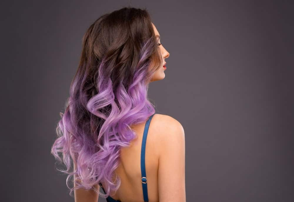 Another bold look, this style consists of purple hair highlights that are almost similar to lavender. This is ideal for those who love to experiment with their hair and have a thing for flashy and bold colors.
