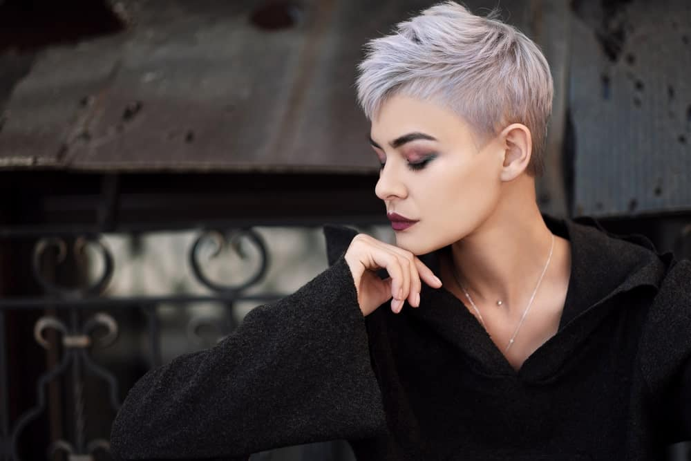To achieve the undercut pixie look, keep the hair on the back super short, while leaving the ones on top longer. Ask your stylist to give your hair some choppy layers to give it volume. Dye it silver and purple for a gothic, grunge look.