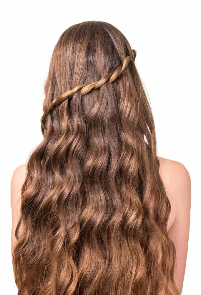 A swooping waterfall twist can be a beautiful addition to hair that is wavy throughout. It's a hairstyle that makes it feel like your hair is flowing from the twisting strand of hair and will definitely be a hairstyle to stand out in the crowd.