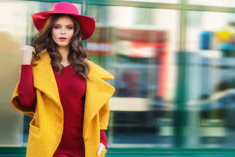 A good floppy hat can take a regular head of waves and make it look super glamorous. Add a bright pop of lipstick and you've got yourself a classic street style look!
