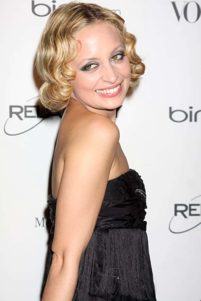 Nicole Richie looks super unique with her one-of-a-kind hairstyle. This is a super short, curly bob with highly defined and rounded curls with a classic middle parting. This is one of those hairdos that is only for people with a strong heart and an aptitude to go big and bold!