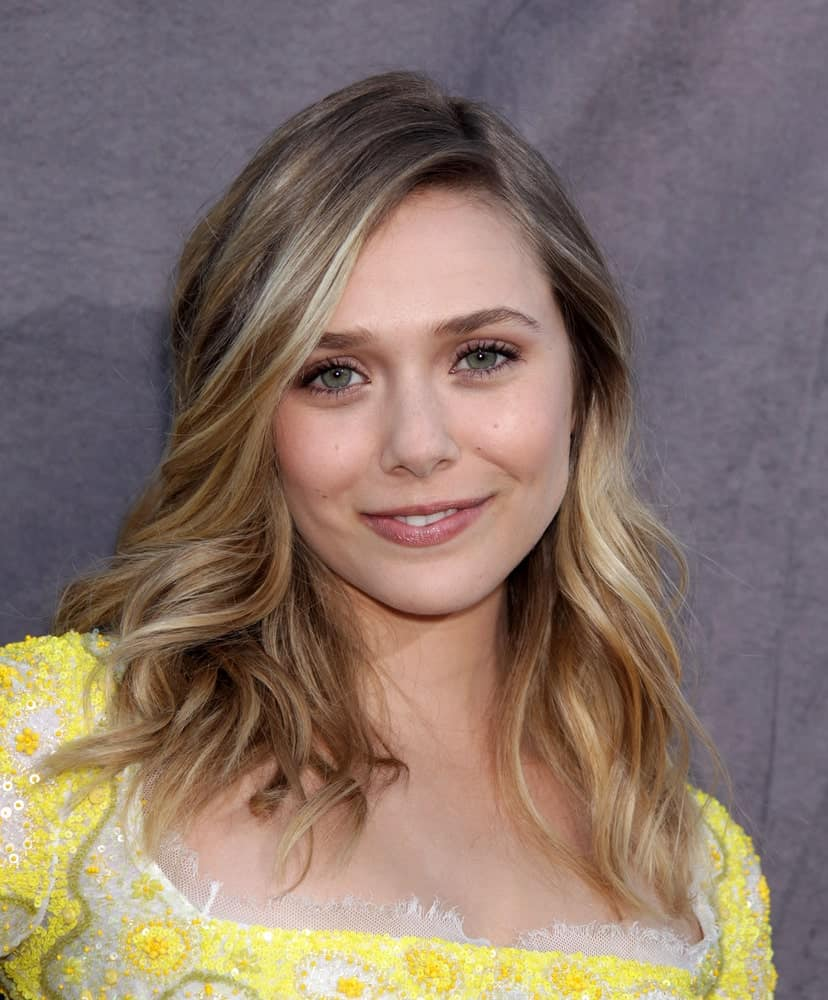 Here we see the young and pretty Elizabeth Olsen rocking her short hair with highlights. Side-sweeping her wispy shoulder-length hair, she has used light blonde highlights that are darker near the roots. The result is a forever-sun-kissed hairstyle that is simply to die for.