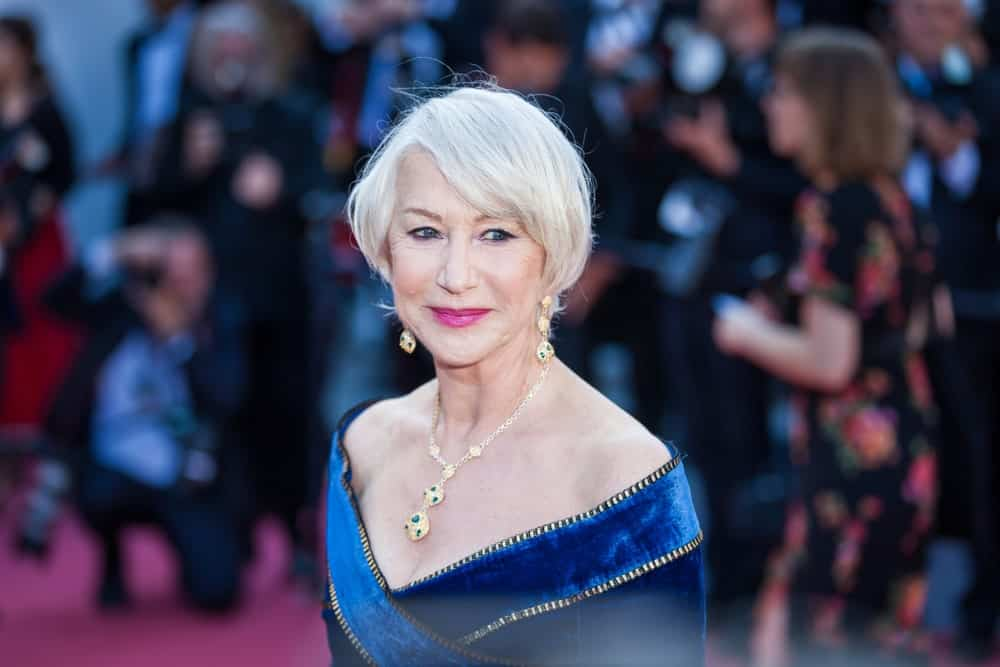 The ever-beautiful and elegant Helen Mirren wanted all eyes on her gorgeous dress and jewelry, so she kept her platinum-silver hair simple. The look can be achieved by air drying your pixie cut and sweeping the bangs casually to the side.