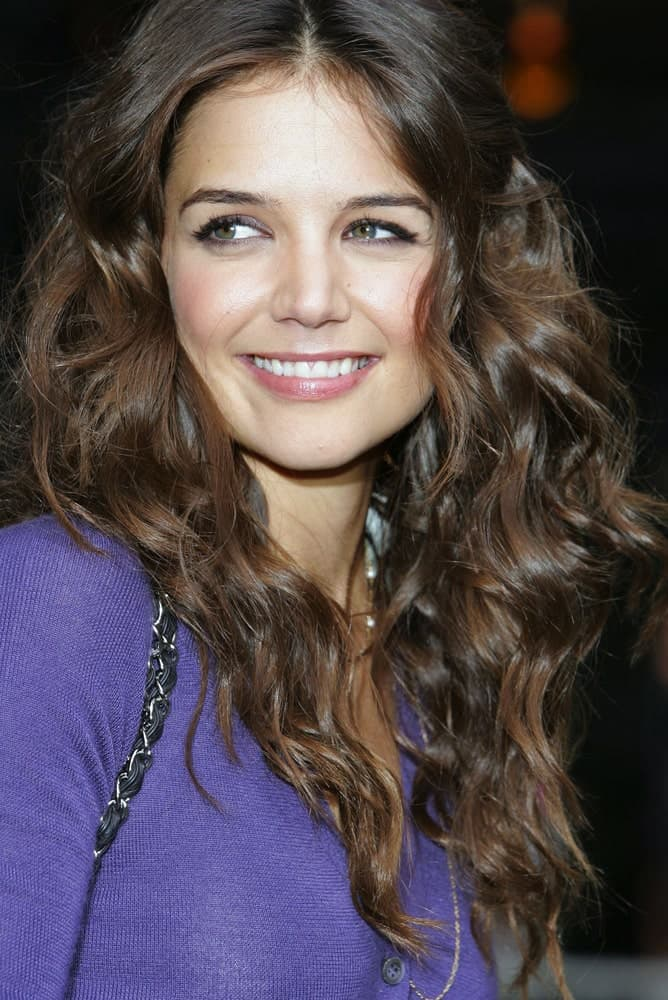 Katie Holmes has repetedly used the tousled look to highlight her girl-next-door features. Her hair looks perfect in the soft brown color.