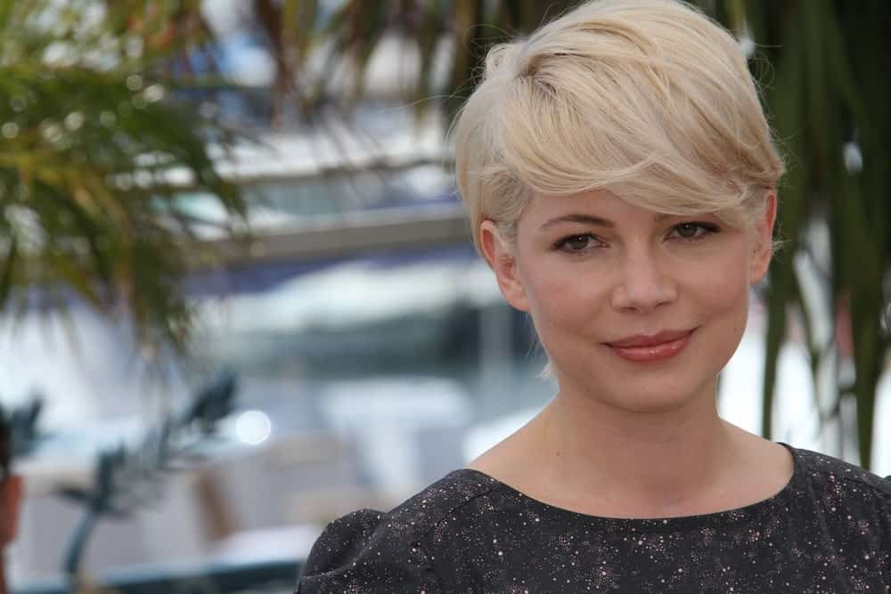 For a low-maintenance but sweet pixie cut, add just a bit of texturizing mist to your hair and blow dry the long bangs to the side in an artless way. Get your inspiration from Michelle Williams.