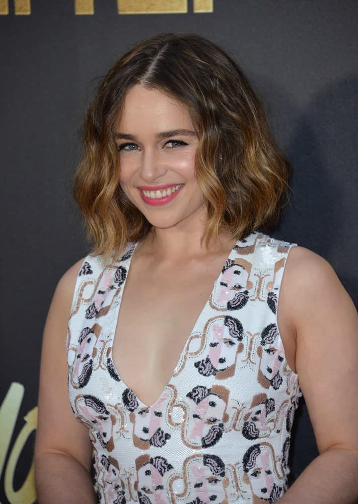 A short bob can do wonders for your jawline since it frames the face perfectly. With tousled hair, the bob looks really cute. Emilia Clarke has paired the style with some nice blond highlights that bring out the curls in the hair.