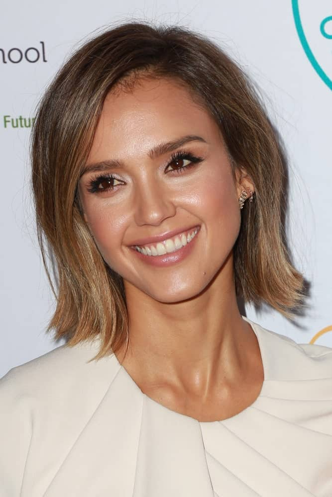 One of the primary benefits of having short straight hair is that on most days, you do not need to do anything other than running a comb through your hair in the morning and that's it - you are set for the day! Jessica Alba proves this point here with her easy-going, trouble-free hairstyle for women with short straight hair. A few lowlights can provide a lot of luster and shine if you want to add a fancier touch.