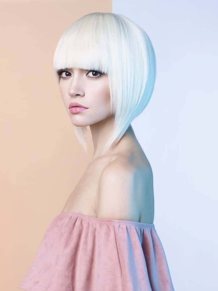 For the love of Blonde – go for whitish blonde if you are a fan of lighter color hair. With full front fringes and V-bob cut, this hairstyle is all about creating a contemporary look. If you have short hair, love blonde hair, and are a fan of fringes – this just might be the hairstyle for you.