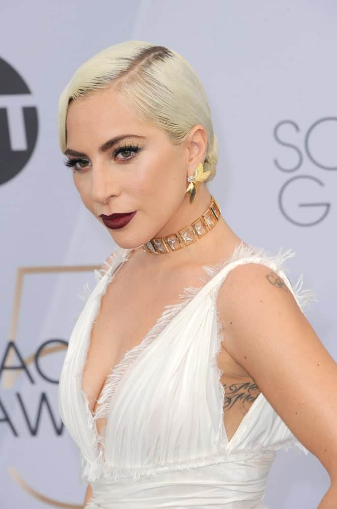 Many women think that having short straight hair means struggling with a thin, flat look. But the legendary Lady Gaga shatters this misconception beautifully – or rather embraces it with open arms. Despite slathering her straight hair with gel and going for a plain minimalistic hairstyle, she manages to shine in a way few others can do.
