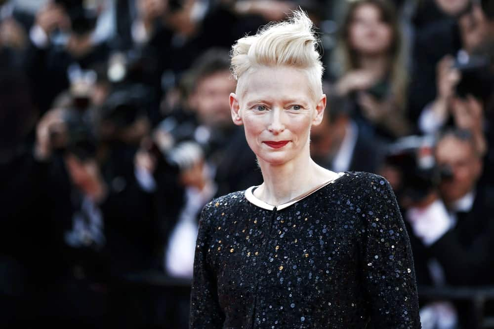 Tilda Swinton has worn her hair super short for several years and has tried dozens of glamorous styleson it. This one features a very extra pompadour that flips her long front hair back. The actress has lefther side hair much shorter and it makes for a super-cool and fun style.