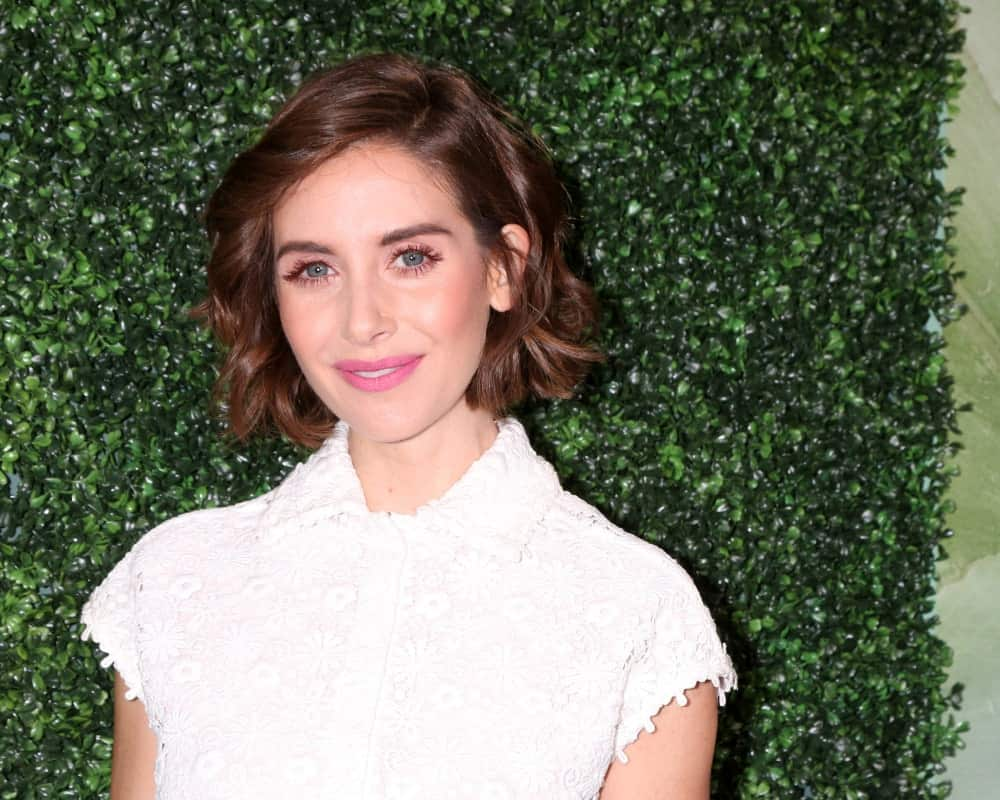 This is the gorgeous Alison Brie looking like a diva in this short hairstyle. It is a super short bob with slightly waved and curled hair that looks super bouncy and full of volume.