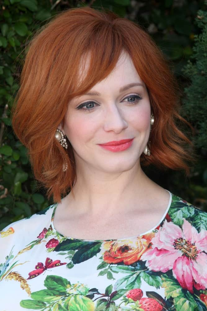 A prim and proper haircut eliminates the need for further styling and this short red hairstyle for women illustrates this statement perfectly. A wispy bob with a pointed side-swept bang is bound to look extraordinary.