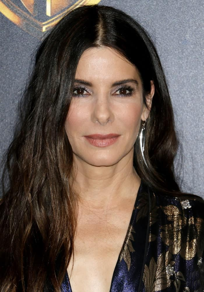 Sandra Bullock is the Queen of Tousled Hair since she often pairs the messy hair with a parting in the middle. The hair frames her face perfectly, which is a look that would look great on everyone.