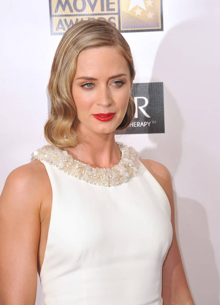 Who knew that a single hair clip could add so much character to a simple hairstyle for women with short straight hair? The talented Emily Blunt has gone for a slight wave and a neat side-parted look for a style that is oozing beauty.