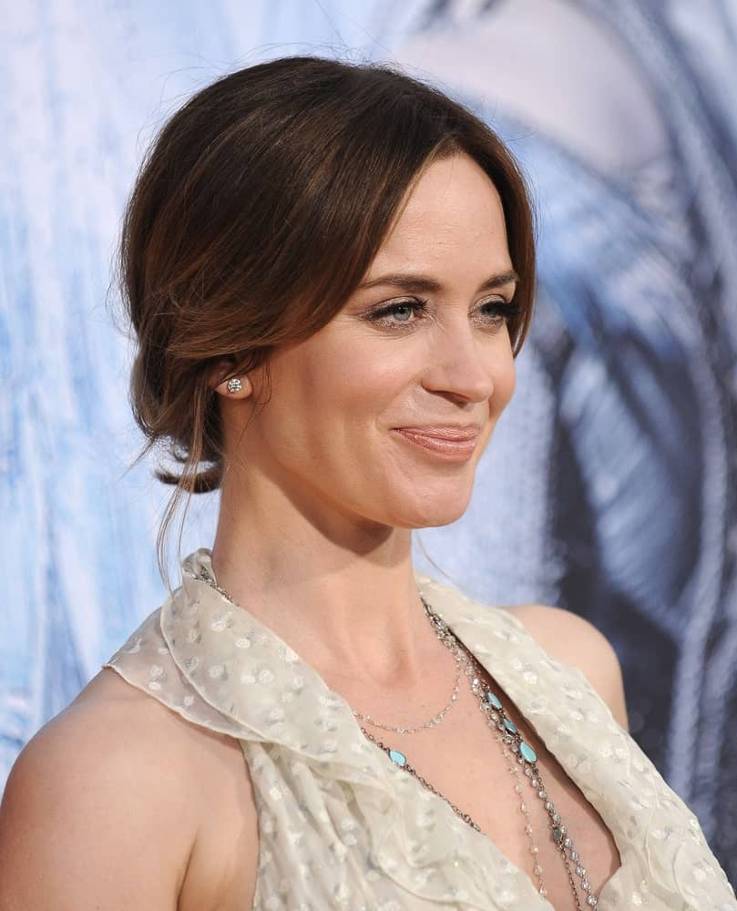 Here is another short and tied hairstyle by none other than Emily blunt. This is best for days when you don't feel like letting your hair down so you might as well just pin it in a cute bun at the back of your head and part it from the middle in the front to give it that regal look.