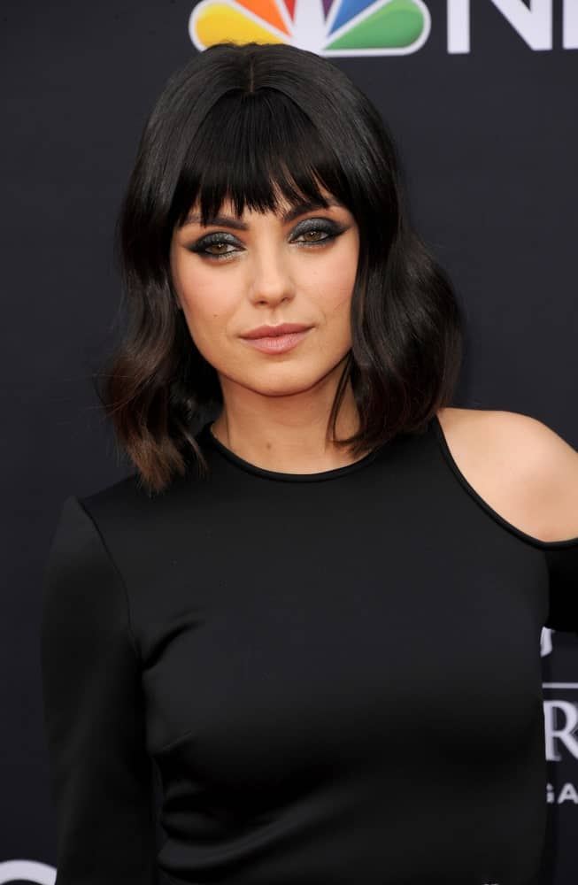 Mila Kunis has always been an advocate of short hair. Here the talented actress has opted for a rather long bob (or 'lob') that extends all the way down to her collarbone. A neat center-part, loose waves ending in feathered layers and eye-skimming, irregular bangs come together in this attractive layered bob haircut for women.