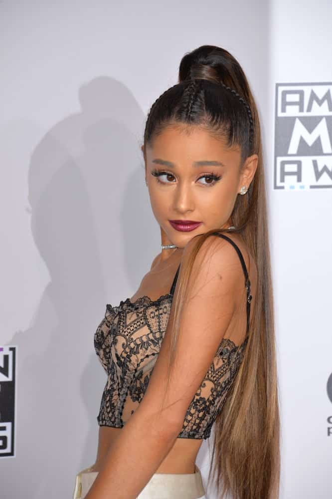Think of celebrities wearing a ponytail and Ariana Grande is likely to be the first one to pop up in your head. Her signature ponytail hairstyle comprises of extra long and extra straight hair secured firmly at the top. This style might not be for everyone but it's definitely worth considering if you are looking for a style that is truly jaw-dropping.