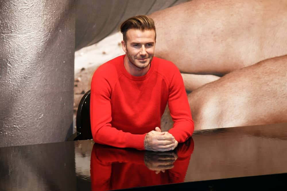 Before David Beckham showed up at Prince Harry's and Meghan Markle's wedding with a feathery crop and made the world swoon, the former Manchester United football player used to rock a slicked-back pompadour style. However, this look doesn't come easy. To achieve the style, you need to blow-dry your hair, then add texture spray or mousse before a light pomade,and then fix it in place with some hairspray.That's how many products and stages it requires.