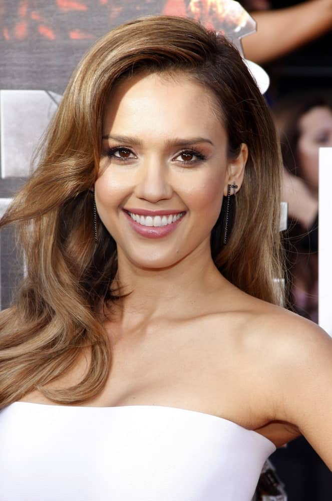 Jessica Alba's loose hairstyle for women with long hair features wearing hair down in a side-parted style. It might take some hairspray to add that lustrous finish but the style is the right mix of casual and elegant.