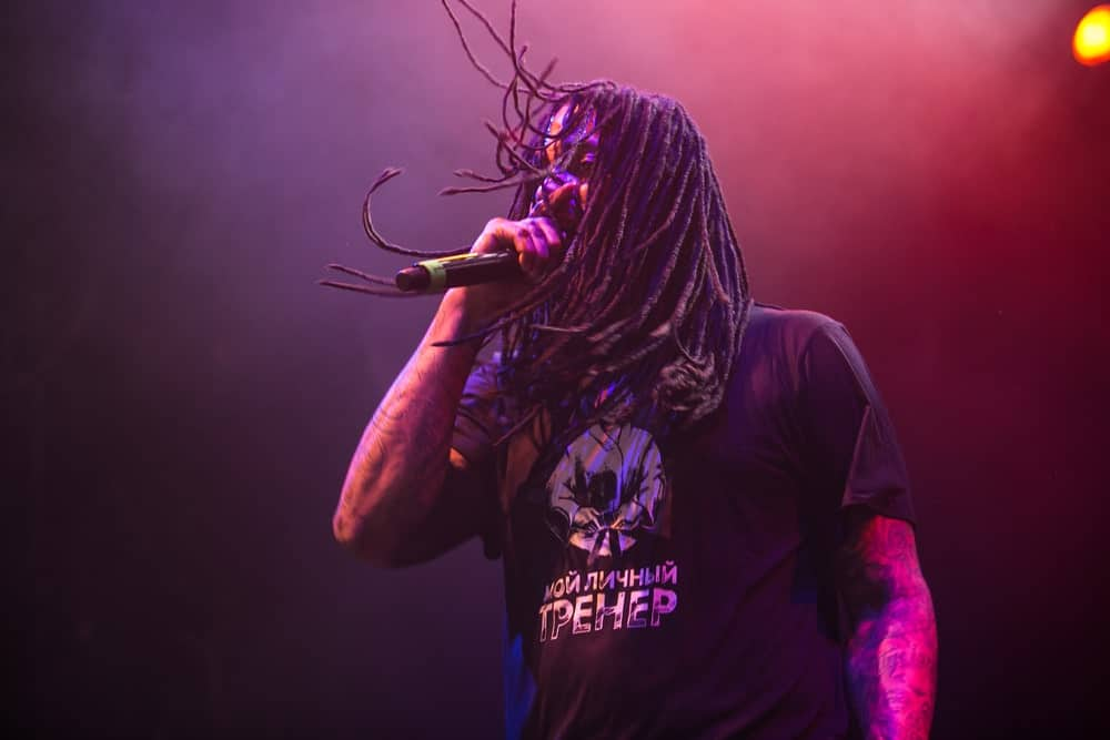 This is the famous hip-hop singer Wacka Flocka Flame, originally known as Juaquin James Malphurs, who has almost never been seen without his signature dreadlocks! Here, he has let loose his dreads that elegantly fall down on his shoulders.