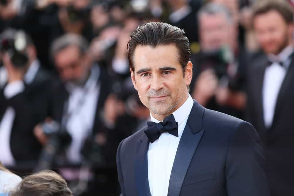 This great hairstyle worn by Colin Farrell is perfect for those men who want to keep their hair away from their face. Here, Farrell has kept the top of his hair about 4 to 6 inches long. However, his sides have been clipped shorter,but not too much. The shorter sides give his style balance and the top of his hair more volume. The slicked-back look gives Farrell a tidy appearance and is eye-catching and dramatic. It is a wonderful outgoing style.