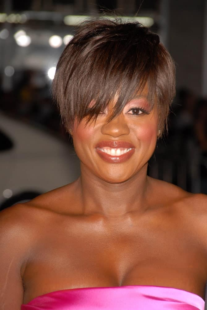 This side-swept haircut for women comprises of nothing but a really carefully planned movement of scissors. Viola Davis looks extremely stylish in this extra choppy and extra deep pixie cut that reaches far below her eyes.