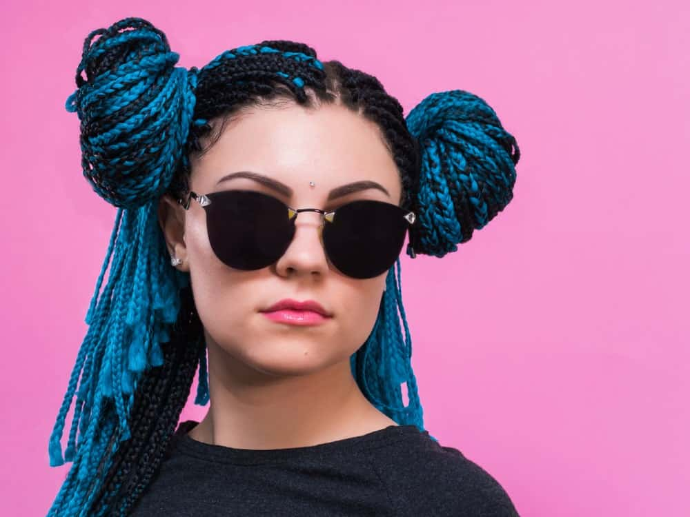 For some extra edgy and hipster vibes, try this fun style. Ask your stylist to twist your hair into Fulani braids and weave it together with Smurf-blue threads and tassels. These tassels can be much longer than the actual length of your hair. However, if you feel that all the extra length is cumbersome, just part your braids into two sections and wrap it into twin buns on the side of your hair, Princess Leia style.