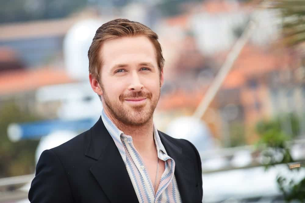 """This unassuming style sported by Ryan Gosling is beautiful in its simplicity. The """"La La Land"""" actor chose to style his hair in a simple brush-up style rather than one that would stick out in the crowd. To get the look, cut your hair into medium-length feathery locks on the top and slightly shorter ones on the side. Add a bit of pomade to your hair just to push back and set your hair in place, but make sure that you don'tslick it down completely. This style is humble and perfect, just like the actor himself."""