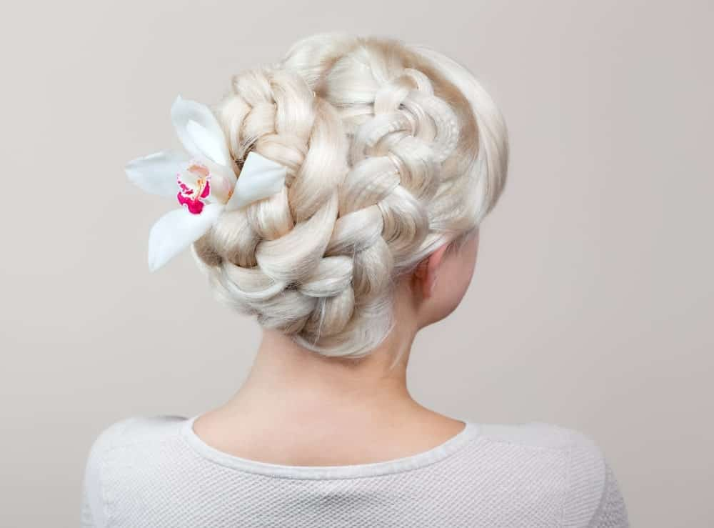 Since paler than pale hair is all the rage these days, many girls are opting to walk the aisle with platinum or white-dyed hair. For a great wedding look, those with long hair can create beautiful and elaborate updos. This style features two thick braids that start from the crown of the head and coil at the back to make an easy-to-do yet elaborate looking hairstyle.
