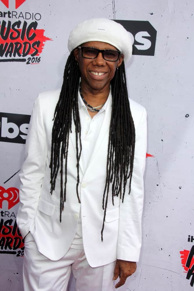 These have to be the ultimately classic dreadlocks being rocked by none other than Nile Rodgers, the American record producer, musician, and songwriter. He has super long dreads that have been let loose in the front on both the sides. He has further upped the look with the help of a white hat that acts as a great contrast against his jet-black dreadlocks.